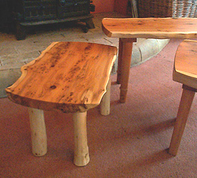 Photograph of some tables in rustic style with character wood tops