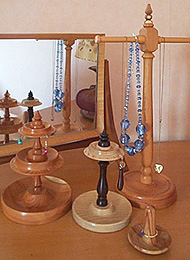 Photograph of turned wooden jewellery stands
