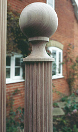 Photograph of detail at the top of a turned column
