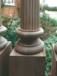 Photograph of detail at the base of a turned column