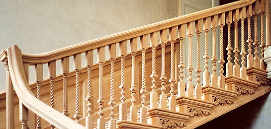 Photograph of a staircase using turned handrail spindles