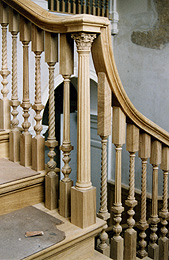 Photograph of turned stair handrail spindles